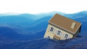 A house sinking in blue waves. Very high resolution 3D render.